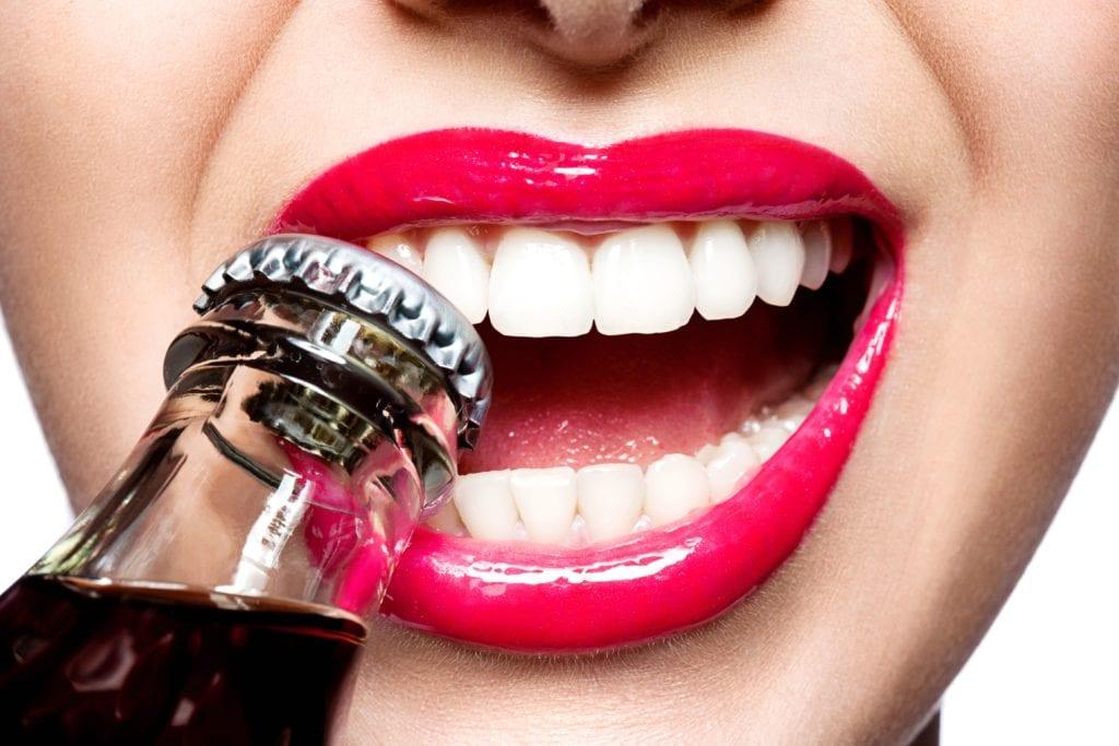 using teeth to open bottle